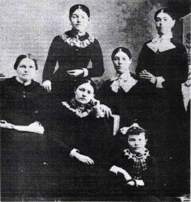 Standing: Eunice, Ellen Seated Middle: Mrs. Cornish, Mary Ann, Nancy Seated Front: Janie